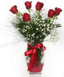 7 adet gülden cam içerisinde güller  İzmir Konak çiçek gönderme